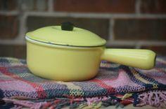 I petite vintage Le Creuset pan with lid.
