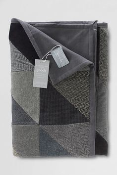 Patchwork Quilted Throw from Lands' End. Made with  recycled wool and wool-blend men's jackets. Since it appears there's no actual quilting, I'd be interested to see if this was tied, or loose, or another method of keeping the quilt sandwich together.