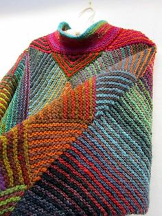 A poncho made from panels of mitered diamonds and triangles with the largest diamond based on 70+1 stitches. See this page for the pattern: http://fibermania.blogspot.com/p/mit...