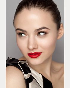 We love the look of bold, red lips and even more so when this vibrant color is paired with soft, neutral eyes. If you are used to wearing red lipstick, then by all means this is a look that you can pull off on your wedding day and feel comfortable wearing. To not look too overdone, opt for shimmery champagne, nude or light brown shadow, which can be worn alone or with black winged liner for a more dramatic look. Need some inspiration? Check out these 10 looks that are the perfect example!