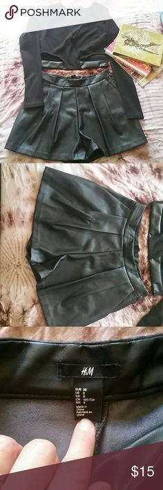 H&M Highwaisted black pleather shorts In beautiful condition more than maybe a handful of times for my promo job but they're gorgeous and don't fit me anymore- has a zipper on the side with a button-  go perfect this winter with a crop and some leggings add some platforms... super cute:)!- (top and books not included) H&M Skirts