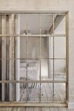 what a beautiful little flat in Prague, with all natural tones, open plan and wonderful material such as the light grey oak floor... special crush for the window separation in the bedroom!!! soft indu