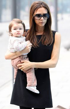 only victoria beckham can look stylish and put together all while holding an adorable little baby