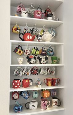 disney cups mugs collection. mugs collection. mugs collection. mugs collection. Disney Diy, Casa Disney, Disney Rooms, Disney Kitchen Decor, Disney Home Decor, Photos Folles, Disney Tassen, Motif Mandala Crochet, Coffee Mug Display