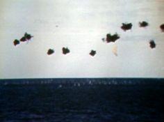 Flak bursts around a Japanese plane attacking Midway Islands, 4 June 1942.