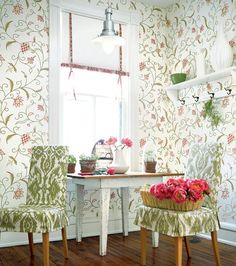How sweet!  Love #Thibaut's Pink English Crewel wallpaper with from the Fairfax Collection with chairs covered in Green Ikat fabric    #English #wallpaper #floral #pink #green #ikat #breakfastnook #rollershade #cabbageroses