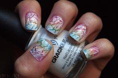 Crackle nail polish over rainbow nails.
