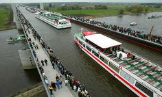 Magdeburg Water Bridge, Germany    The Magdeburg Water Bridge is a navigable aqueduct in Germany, opened in October 2003. It connects the Elebe-Havel Canal to the Mittelland Canal, crossing over the Elbe River. It is notable for being the longest navigable aqueduct in the world.