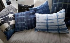 Pillows made from the shibori dye technique are on display at the workshop Tuesday July 15, 2014. Carrie Crawford and her Mineral Workshop in Fairfax, Calif. produce shibori, a Japanese fabric dyeing technique she uses for wall hangings and pillows. Photo: Brant Ward, San Francisco Chronicle