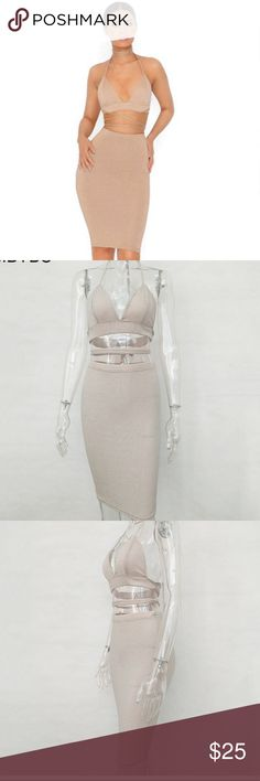 Gold Sparkly Two Piece Bodycon Skirt and Top New Sparkly Two Piece Bodycon Skirt and Top in size Medium. Runs small. Fits like a size Small. Thick Sparkly Gold material. Color is a pale gold. Measurements: Bust- 34 inches, Waist- 25 inches, and Hips- 35 inches. Dresses