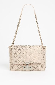 Yes. MARC JACOBS Baroque Studs Leather Crossbody Bag