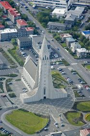 """""""The largest church in Iceland (Hallgrimskirkja) and the 73-metre high church tower offers a stunning view"""" of the town of Reykjavik and the island's mountains."""