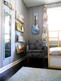 This is a great gender neutral bedroom for kids...love the way they displayed the books, guitar, and musical instrument!
