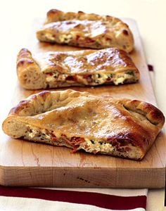 Double-cheese and prosciutto calzone - with mozzarella, goat cheese, prosciuto, garlic, fresh thyme and olive oil
