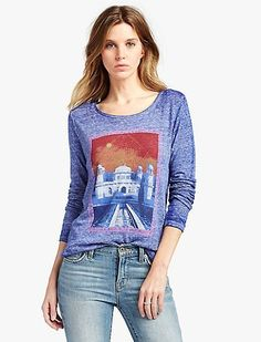 Travel-inspired tee crafted from textured triblend fabric. Features a scoop neck, long sleeves, crossover back detailing and a colorful Taj Mahal graphic at front.