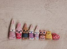 Painted rocks (bunnies in stripes, too cute)