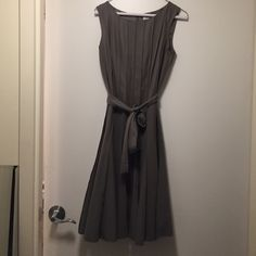 Worn once. Gray, tie belted, sleeveless slightly flared dress with raised gray piped stripes. Good for professional party/dinner. Calvin Klein Dresses Midi