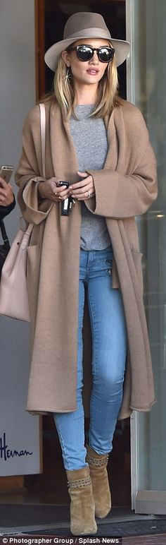 Head turner: The English beauty emphasized her long limbs with skinny jeans and ankle boots which she paired with a long camel cardigan