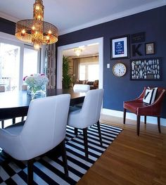 In the dining room: Navy walls, a vintage-style brass pendant light and a black and white striped rug come together here for a crisp, modern. Dining Room Blue, Dining Room Walls, Dining Room Design, Dining Area, Dining Chairs, Kitchen Dining, Navy Kitchen, Dining Table, Kitchen Nook