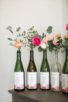 Easy Spring Wedding Decorations on a Budget - Upcycled Flower Vases wine bottle seating chart - Wedding Ideas