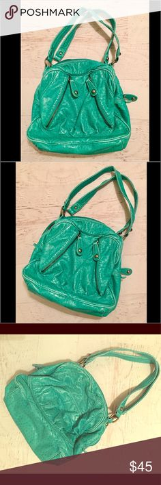 Kathy van Zeeland turquoise leather satchel Kathy van Zeeland turquoise leather with ostrich embossing and silver hardware. VERY ROOMY, lots of zippered pockets and pockets on inside. Purse opens very wide and has gorgeous colors throughout. No wear or tear that I can tell. This is an awesome and super UNIQUE bag! Kathy Van Zeeland Bags Satchels