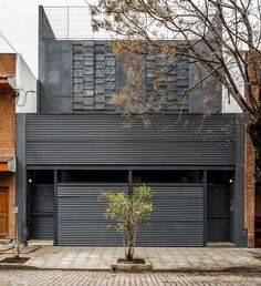 Two clients joined forces to commission one building with two separate homes by Buenos Aires studio Hitzig Militello Arquitectos »