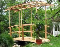 """12' Monet's Red Cedar Bridge w/ Curved Wisteria Canopy by Fifthroom. $2199.00. Features beautiful curved trellis canopy. Free Shipping; comes partially assembled. Protected by 1 year limited warranty. 12' x 52.5""""W; Max span: 118""""; Capacity: 350lbs. Hardware: Zinc Plated Steel. Here I have created a scaled-down replica of Monet's famous Japanese arched bridge complete with wisteria canopy. This design features a curved canopy that follows the lines of the bridge that cros..."""