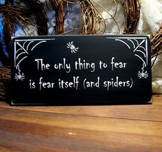 The Only Thing to Fear is Fear Itself and Spiders Wood Sign Halloween Painted. $13.95, via Etsy.