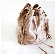 Grace Atelier DeLuxe placement on Could I Have That fringe leather handbag. Made in Greece. #adventurebag