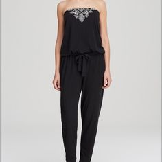 Lucky Brand Moroccan Jump Suit Bandeau style jumpsuit with embroidered front. Ties at waist, long tapered legs. Lucky Brand Pants Jumpsuits & Rompers