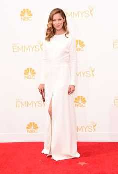 Brides.com: The 2014 Emmy Dresses Brides-to-Be Need to Check Out Slits always have their moment on the red carpet, and Michelle Monaghan rocked the trend with a white Giambattista Valli Couture gown. This look is perfect for a fall or spring wedding giving that dose of sexy for the bride who believes her legs are among her best assets.Photo: Getty Images