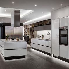 Linear Trend Grey is the new go-to neutral. This colour is very popular and a great choice for a kitchen as it is both versatile and fresh. This is our Balham Gloss Dove Grey kitchen. Find out more at Howdens. Luxury Kitchen Design, Kitchen Room Design, Home Decor Kitchen, Kitchen Interior, New Kitchen, Kitchen Modern, Modern Grey Kitchen, Modern Kitchens, Kitchen Layout