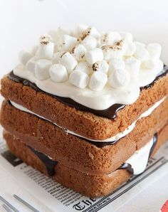 Ok so they've called it a 'S'mores Birthday Cake' but if you love these gooey treats more than anything why not have a S'mores Wedding Cake?