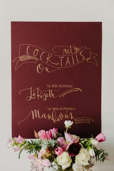 marsala and gold cocktail sign - photo by Kai Heeringa Photography http://ruffledblog.com/modern-romantic-wedding-ideas-with-marsala
