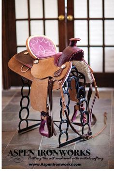 Saddle stand made from recycled horseshoes
