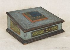 Lancaster or Berks County, Pennsylvania painted sewing box, late 18th century, the slant lid with an attached pincushion, retaining an old blue surface with green stipped panels and strap hinges, 6.75 H. x 14.5 W. x 12.75 D.