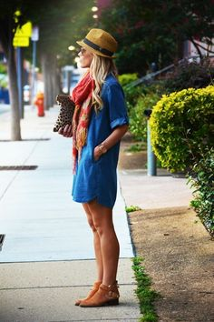 Denim dress with a colorful scarf for a pop of color.