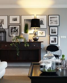 pretty off white white cream walls with framed black and white photographs, perhaps i could take some?