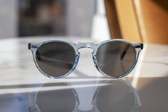 An OLIVER PEOPLES Icon Reimagined - Gregory Peck Sun in Light Denim.  Yes! Gregory Peck, Oliver Peoples, Light Denim, Ray Bans, Sunglasses, Style, Fashion, Swag, Moda