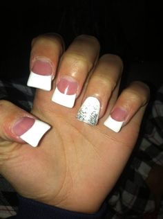 Classic White French Tips With Silver Glitter On Ring Finger