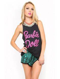 BARBIE DOLL Muscle Tank: Sleeveless mineral wash knit top featuring a scooped neckline with double stitching. Large front text 'Barbie Doll'. Double stitching on hemline and racerback. Unlined. Knit. Lightweight. Machine wash cold XS $14.99