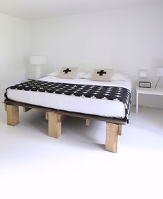 The bed is a DIY out of 2 sections of dock and legs. However, looking at it, it appears to be pallets and I thought - why can't you reuse pallets to make this bed?