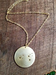 Who wouldn't love this Leo Constellation Necklace by Oceanne on Etsy, $48.00. Maybe there is a cheaper version somewhere?