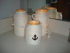 DIY nautical bathroom decor. Mason jars, soft rope, and hot glue gun.