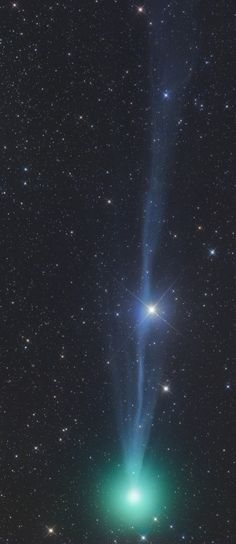 "Comet Lovejoy: ""Gerald Rhemann took this picture on Dec. 21st [2014] using a remotely-operated telescope in Namibia. The comet's sinuous blue ion tail contrasts beautifully with its puffy green atmosphere."""