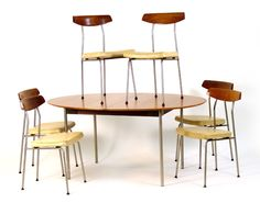 John and Sylvia Reid for Stag Furniture, an oval teak dining table and six metal and teak chairs