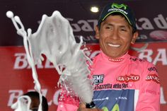 Colombia's Nairo Quintana celebrates on the podium after completing the 17th stage of the Giro d'Italia from from Sarnonico to Vittorio Veneto, Italy, Wednesday, May 28, 2014. Stefano Pirazzi won the 17th stage, while Nairo Quintana retained the overall leader's pink jersey.