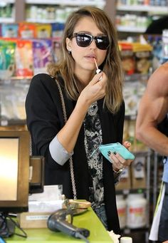 'Barely Lethal' actress Jessica Alba grabs a couple salads to go on October 3, 2013 in West Hollywood, California.