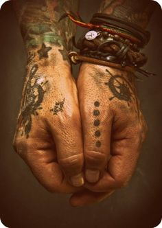 Tattooed hands and cool bracelets (the hands of Nikki Sixx)