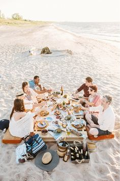 People eating around the table at beach party